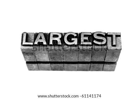 LARGEST written in metallic letters on a white background - stock photo