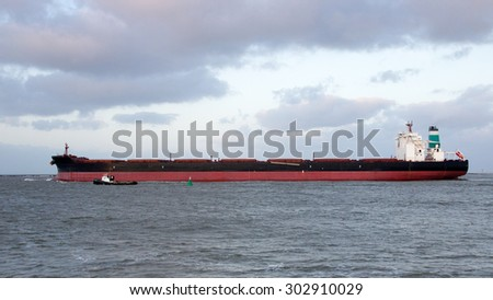 Largo ore bulk carrier leaving the Port of Rotterdam. - stock photo