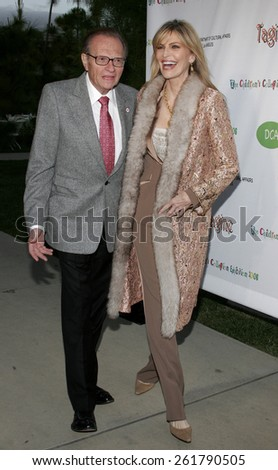 """Larry King and Shawn Southwick-King attend the opening of """"The Children's Collection"""" held at the Junior Arts Center Gallery at Barnsdall Park in Hollywood, California on April 22, 2006. - stock photo"""
