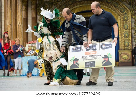 LAS PALMAS - FEBRUARY 3: Thor (dog), Gisela Betancor (l) and unidentified people from Canary Islands, receiving 1th prize, during the Carnival's Dogs Contest February 3, 2013 in Las Palmas, Spain