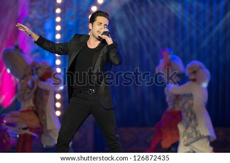LAS PALMAS, SPAIN - FEBRUARY 1: Singer David Bustamante (m) from  Spain, with unidentified dancers, performs onstage during the carnival Queens Gala on February 1, 2013 in Las Palmas, Spain. - stock photo