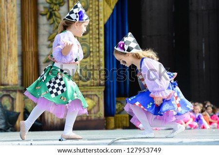 LAS PALMAS, SPAIN -FEBRUARY 10: Unidentified children from Escuela de Danza Bellarte, from Canary Islands, performing during Children's Costume and Murgas, on February 10, 2013 in Las Palmas,Spain - stock photo