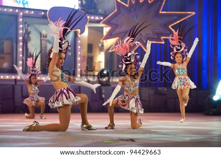 LAS PALMAS, SPAIN - FEBRUARY 4: Unidentified children from the dance-group Comparsa Infantil Cubatao, from Canary Islands, perform during the children's dance (comparsas) contest on February 4, 2012 in Las Palmas, Spain. - stock photo