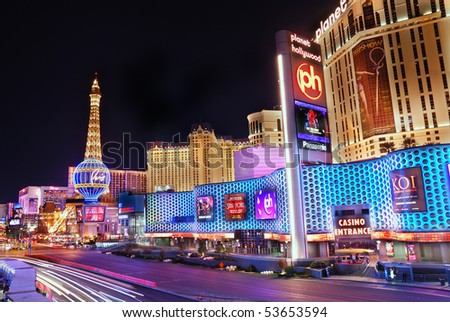 LAS VEGA, NEVADA - MARCH 4: Paris Hotel and Casino with colorful light and traffic, March 4, 2010 in Las Vegas, Nevada. - stock photo