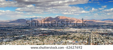 Las Vegas Aerial Panorama with city skyline, mountain and streets.