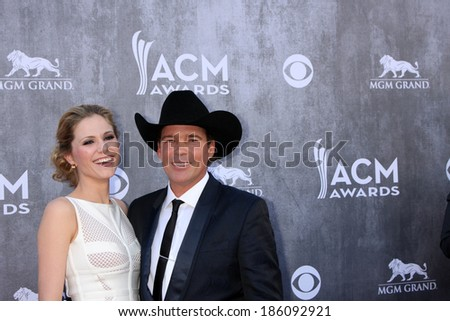 LAS VEGAS - APR 6:  Jessica Craig, Clay Walker at the 2014 Academy of Country Music Awards - Arrivals at MGM Grand Garden Arena on April 6, 2014 in Las Vegas, NV