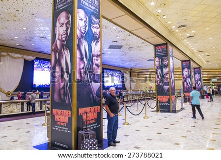 LAS VEGAS - APR 28 : Posters at the MGM Grand hotel lobby advertises about the Floyd Mayweather and Manny Pacquiao fight on April 28 2015 in Las Vegas , the fight scheduled to May 2 2015 - stock photo