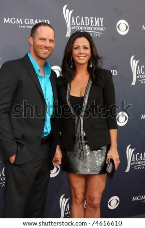 LAS VEGAS - APR 3:  Sara Evans & Husband arrive at the Academy of Country Music Awards 2011 at MGM Grand Garden Arena on April 3, 2010 in Las Vegas, NV. - stock photo