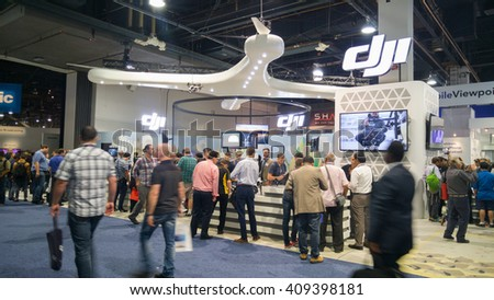 LAS VEGAS - April 18, 2016: DJI booth at NAB 2016, an annual trade show by the National Association of Broadcasters.1700+ exhibitors on 2000000 sq feet space of Las Vegas Convention Center. - stock photo