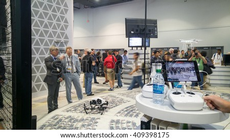 LAS VEGAS - April 18, 2016: DJI Phantom 4 quad copter drone remote controlled flight demonstration at DJI booth at NAB 2016 in Las Vegas Convention Center. - stock photo