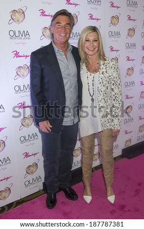 LAS VEGAS - APRIL 11: Entertainer Olivia Newton-John and her husband, John Easterling, attends the grand opening of her residency show 'Summer Nights' at Flamingo Las Vegas on April 11, 2014  - stock photo