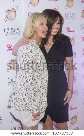 LAS VEGAS - APRIL 11: Entertainer Olivia Newton-John and singer Marie Osmond attends the grand opening of her residency show 'Summer Nights' at Flamingo Las Vegas on April 11, 2014  - stock photo