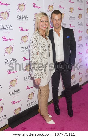 LAS VEGAS, - APRIL 11: Entertainer Olivia Newton-John (L) and actress Joey Lawrence attend the grand opening of her residency show 'Summer Nights' at Flamingo Las Vegas on April 11, 2014 - stock photo