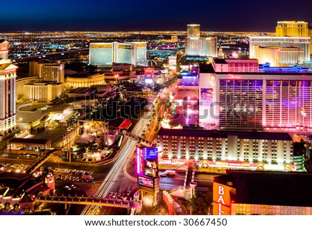 LAS VEGAS - APRIL 2: In this time lapse image, traffic travels along the Las Vegas strip on April 2, 2009 in Las Vegas, Nevada. The strip is approximately 4.2 mi (6.8 km) long. - stock photo