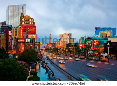 LAS VEGAS - APRIL 15: In this time lapse image, traffic travels along the Las Vegas strip on April 15, 2009 in Las Vegas. The strip is approximately 4.2 mi (6.8 km) long. - stock photo