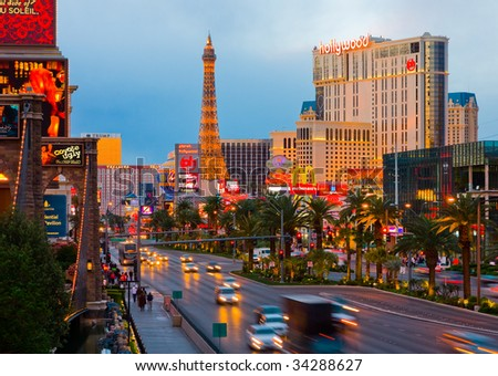 LAS VEGAS - APRIL 15: In this time lapse image, traffic travels along the Las Vegas strip on April 15, 2009 in Las Vegas. The strip is approximately  4.2 mi (6.8 km) long. - stock photo