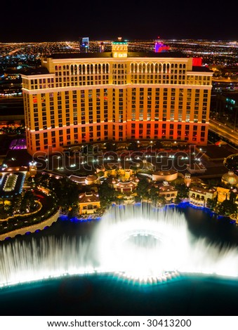 LAS VEGAS - APRIL 2: Musical fountains at Bellagio Hotel & Casino on April 2, 2009 in Las Vegas. The Bellagio opened October 15, 1998, it was the most expensive hotel ever built at US$1.6 billion. - stock photo