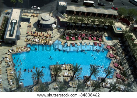 LAS VEGAS - AUG 14: The PH Towers Westgate Pool on August 14, 2011 in Las Vegas. This is an exotic tropical hotel pool  located only a few feet from the resort elevators with 40 private cabanas. - stock photo