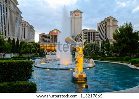 LAS VEGAS - AUGUST 12: Caesars Palace hotel & casino on August 12, 2012 in Las Vegas. It opened on August 5, 1966 and has 3,348 rooms in five towers: Augustus, Centurion, Roman, Palace, and Forum. - stock photo