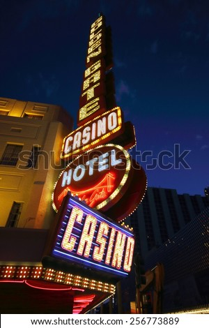 LAS VEGAS - AUGUST 14, 2014: Golden Gate Hotel & Casino sign illuminated by night, on August 14, 2014 in Las Vegas. It is the oldest and smallest hotel located on the Fremont Street Experience. - stock photo