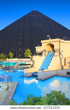 LAS VEGAS - AUGUST 19: Luxor Las Vegas on August 19, 2009 in Las Vegas.  Luxor opened in 1993 and features this pyramid shaped hotel building. - stock photo