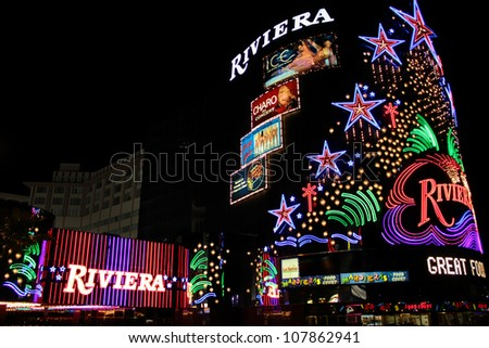 LAS VEGAS - AUGUST 26: The Riviera Hotel and Casino on August 26, 2009 in Las Vegas.  The Riviera is one of the first flashy hotel casinos to open on Las Vegas Boulevard in 1955. - stock photo