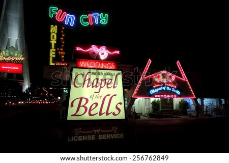 LAS VEGAS - AUGUST 15, 2014: World famous Wedding Chapel of the Bells entrance by night, on August 15, 2014 in Las Vegas. It is located on the Strip, next to Stratosphere Casino, Hotel and Tower.