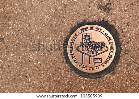 Las Vegas Boulevard sidewalk sign in copper. The 'Right of Way' sign is embedded in the pavement. - stock photo