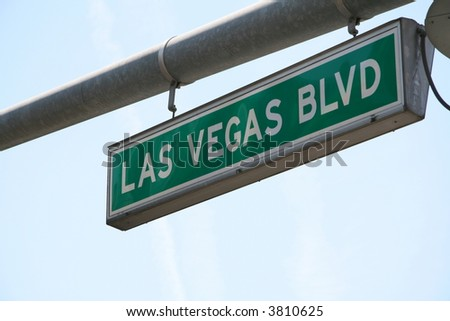 Las Vegas Boulevard Street Sign with jet exhaust in background - stock photo
