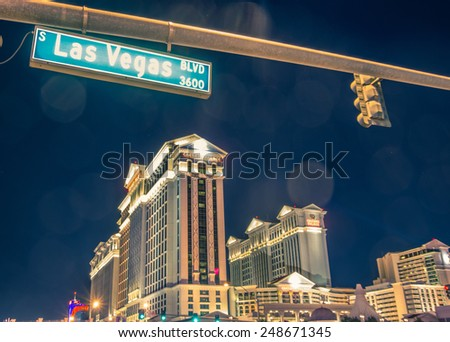 LAS VEGAS - DECEMBER 6, 2013: Caesars Palace and The Strip,Las Vegas. Caesars Palace opened in the 1960's and has a Roman Empire theme. - stock photo
