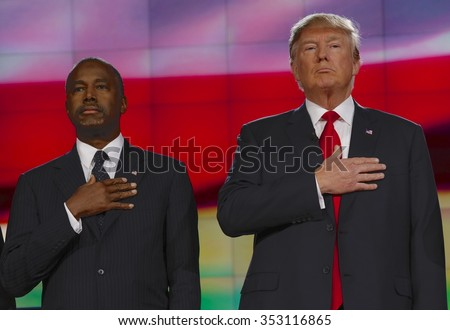 LAS VEGAS  - DECEMBER 15: Republican presidential candidates Donald J. Trump and Ben Carson hold hand over heart at CNN republican presidential debate at Venetian, December 15, 2015, Las Vegas, Nevada - stock photo
