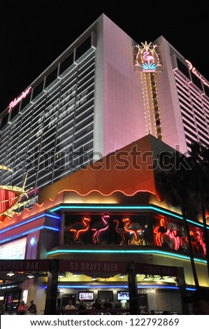 LAS VEGAS - DECEMBER 4: The famous Flamingo Hotel at night on December 4, 2012 in Las Vegas, Nevada.  It was the third resort to open on the Strip & the oldest resort on the Strip still in operation. - stock photo
