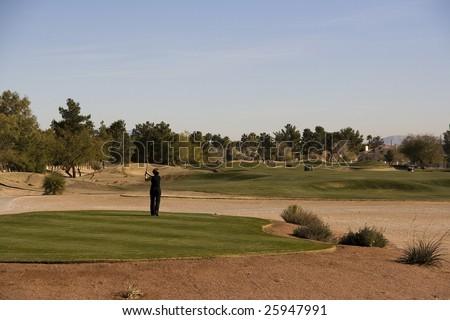 Las Vegas Desert Golf Course Woman Teeing Off - stock photo