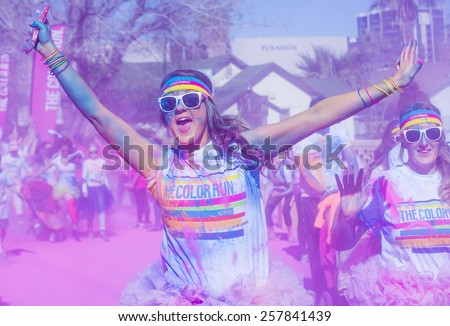 LAS VEGAS - FEB 28 : An unidentified runners at the Las Vegas Color Run on February 28 2015. The Color Run is a 5k worldwide hosted fun race - stock photo