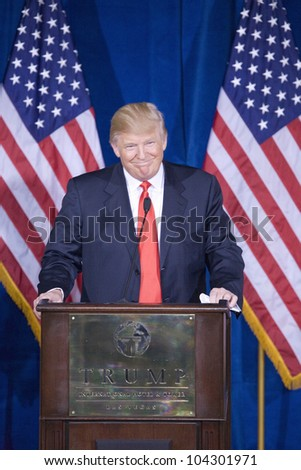 LAS VEGAS - FEB 2: Donald Trump smiles as he endorses Mitt Romney (off camera) for president at his Trump Hotel on February 2, 2012 in Las Vegas, Nevada. - stock photo