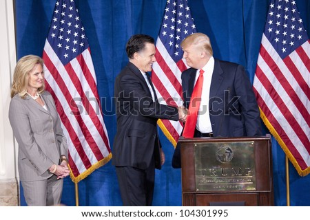 LAS VEGAS - FEB 2: Mitt Romney (C) shakes hands with Donald Trump as his wife, Ann Romney, watches at the Trump Hotel on February 2, 2012 in Las Vegas, Nevada. Trump is endorsing Romney for president. - stock photo