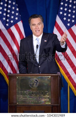 LAS VEGAS - FEB 2: Mitt Romney gestures as he speaks at the Trump hotel on February 2, 2012 in Las Vegas, Nevada. Donald Trump is endorsing Romney for president. - stock photo
