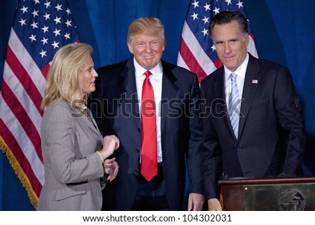 LAS VEGAS - FEB 2: Mitt Romney (R) stands with Donald Trump and Romney's wife, Ann Romney, at the Trump Hotel on February 2, 2012 in Las Vegas, Nevada. Trump is endorsing Romney for president. - stock photo