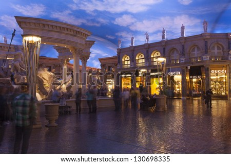LAS VEGAS - FEBRUARY 22:Tourists enjoy the Forum Shops in Las Vegas on February 22, 2013 . The Forum Shops at Caesars Palace has Higher sales per square foot than Rodeo Drive in Beverly Hills. - stock photo