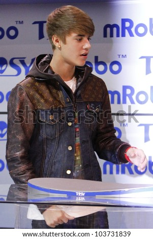 LAS VEGAS - JAN 11: Justin Bieber makes an appearance at the mRobo booth at the Consumer Electronics Show at The Las Vegas Convention Center in Las Vegas, NV on January 11,  2012.