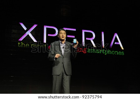 LAS VEGAS - JAN 9: Sony consumer products head Kaz Hirai unveils the new Sony Ericsson Xperia phone at the Sony press conference at the 2012 International CES in Las Vegas, NV on January 9, 2012. - stock photo