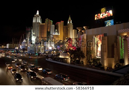 """LAS VEGAS - JANUARY 1: Evening on the Las Vegas Strip, with the """"MGM Grand"""" and """"New York, New York"""" casinos, in Las Vegas on Januray 2, 2009. Recent events have shown gaming isn't recession proof. - stock photo"""