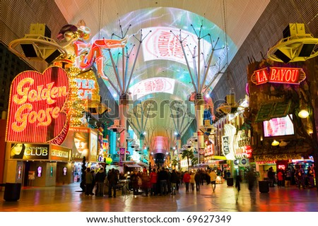 LAS VEGAS - JANUARY 2 : Fremont Street in Las Vegas on January 2, 2011. The street is the second most famous street in the Las Vegas. Fremont Street dates back to 1905, when Las Vegas was founded. - stock photo