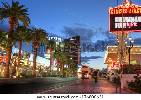 LAS VEGAS, JANUARY 31: Las Vegas Strip at sunset on January 31, 2014 in Las Vegas. It has approximately 4.2-mile (6.8 km) stretch of Las Vegas Boulevard South in Clark County, Nevada - stock photo