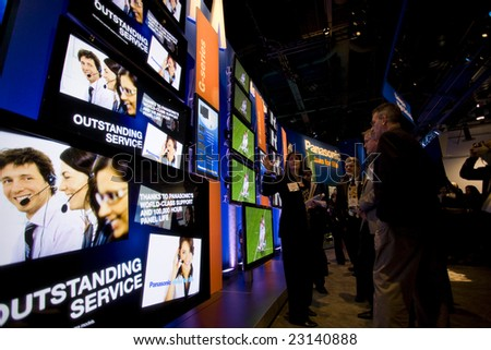 LAS VEGAS - JANUARY 8, 2009: People are looking at an impressive wall of TVs at the 2009 Consumer Electronic Show held in Las Vegas, Nevada, on January 8, 2009.
