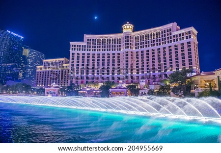 LAS VEGAS - JULY 03 : Bellagio hotel and the dancing fountains in Las Vegas on July 03 2014. Bellagio is a luxury hotel and casino located on the Las Vegas Strip. The Bellagio opened on 1998. - stock photo