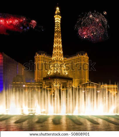 LAS VEGAS - JULY 4: Independence Day  of United State of America, fireworks show over Bellagio fountains and Paris Resort  July 4, 2009 in Las Vegas, USA - stock photo