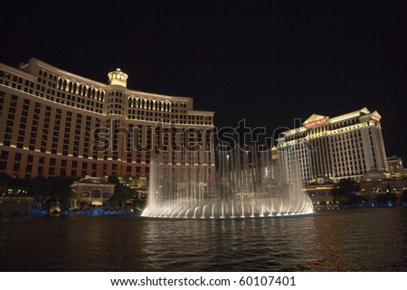 LAS VEGAS - JULY 17: Las Vegas Bellagio Hotel Casino, featured with its world famous fountain show, at night with fountains on July 17, 2008 in Las Vegas, Nevada. - stock photo