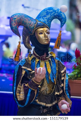 LAS VEGAS - JULY 16 : Performer with Venetian style mask at the Carnevale experience festival in the Venetian Hotel in Las Vegas on July 16, 2013.  - stock photo