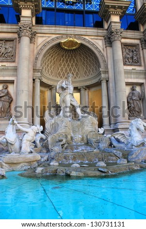 LAS VEGAS - JULY 2: Statue and pool at Caesars Palace Hotel and Casino on July 2, 2012 on the famous Strip in Las Vegas, Nevada. Opened in 1966 with a Roman Empire theme, the hotel has 3,960 rooms. - stock photo